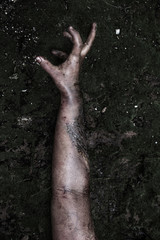Hand of Zombie girl in haunted house