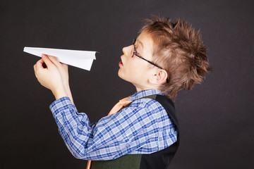 Boy with paper plane