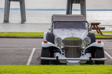 Excalibur vintage car on the beach