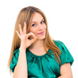Young woman showing OK hand sign smiling happy