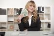 Successful businesswoman waving money