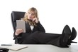 Relaxed business woman holding a tablet