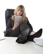 Relaxed businesswoman with her feet on the desk