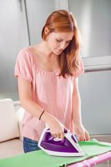 Young Female Ironing