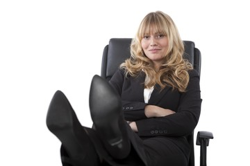 Female executive sitting with her feet up