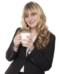 Beautiful stylish woman enjoying a mug of coffee