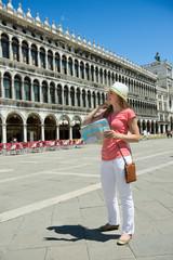 Happy tourist at San Marco square in Venice