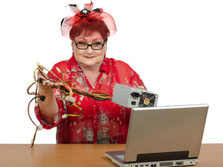 Old woman holding power supply