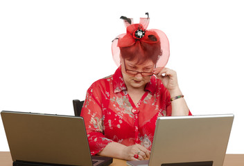 Woman in glasses staring at the laptop screen