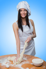sexy girl wearing chef prepares dough.