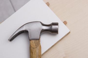 A carpenter builds a closet