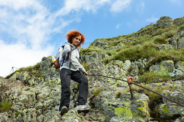Hiker lady in mountains