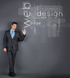 businessman point at web design words
