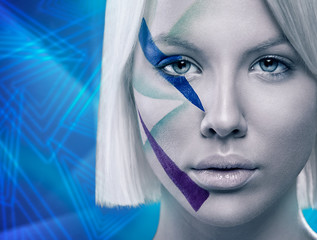 Woman face with futuristic make up