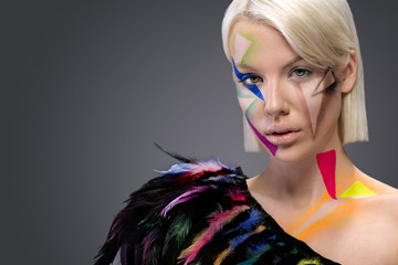 Fashion woman with colorful feathers