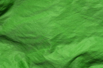 green shiny cloth texture or background