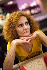 Pensive lady in a restaurant