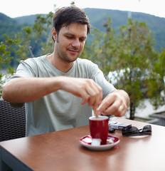 Man having coffee outdoor