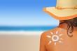 Leinwandbild Motiv Woman with sun shaped sunscreen on her back
