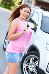 Smiling Caucasian woman holding ignition key in hand