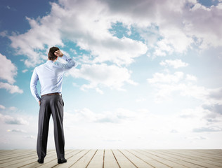 businessman looking at sky