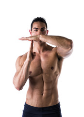 Fit muscular man gesturing time out sign