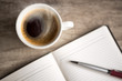 open empty notebook with coffee cup