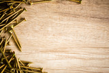 Wooden background with screw