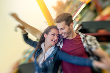 couple enjoy in riding ferris wheel