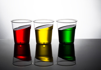Traffic light colour drinks, slanted. Red yellow and green. Stop