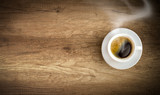cup of coffee on wooden background poster