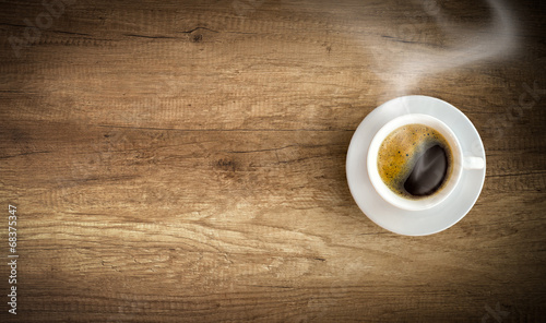 Tuinposter Koffie cup of coffee on wooden background