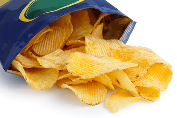 Crinkle cut crisps spilling out of a foil packet.