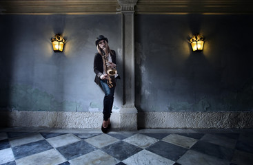 woman in black hat with saxophone