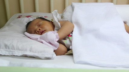 Sleeping asian baby on the wooden bed, dolly shot