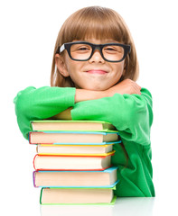 Little girl with a pile of books