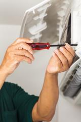 man repair air conditioner