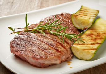 grilled beef steak and zucchini