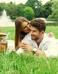 Beautiful couple enjoy a free day on picnic