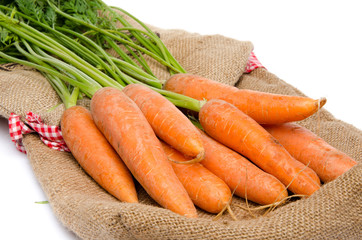 Fresh carrots on a burlap bag