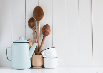 coffee pot, enamel mugs and rustic spoons