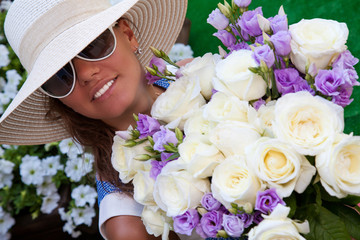 smiling girl with bouquet of white roses