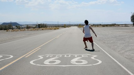 Boy dancing breakdance in the famous route 66 road