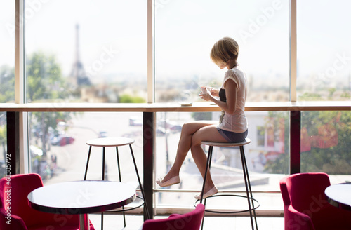 Beautiful girl in a cafe in Paris