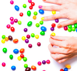 Women's hands gathering candies