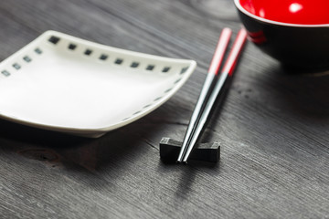 Two chopsticks on sushi mat background