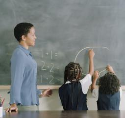 School girls drawing on the chalkboard
