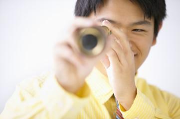 Businessman looking through telescope