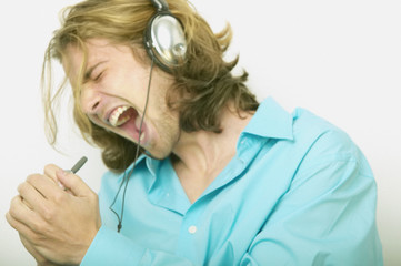 Man with headphone singing to music