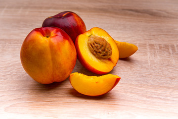 Two and half nectarine on wooden background